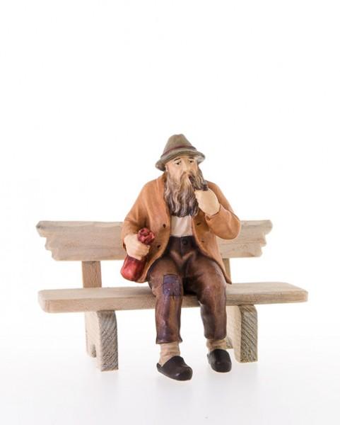 Sitzender Mann mit Bank Nr. 12